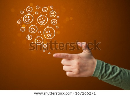 Group of happy hand drawed smile faces coming out of gun shaped hands