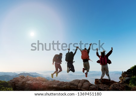 Group of happy hiker jumping on the hill. hiking holiday, wild adventure #1369451180