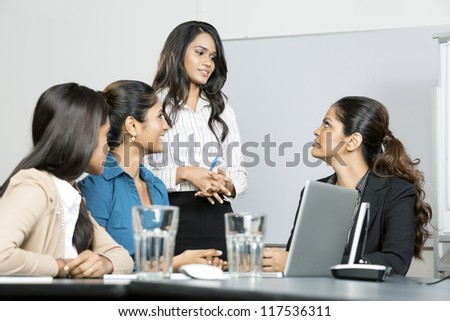 Group of happy Indian business women in a meeting at office