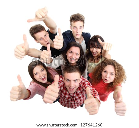 Group of happy joyful friends standing with hands up isolated on white background