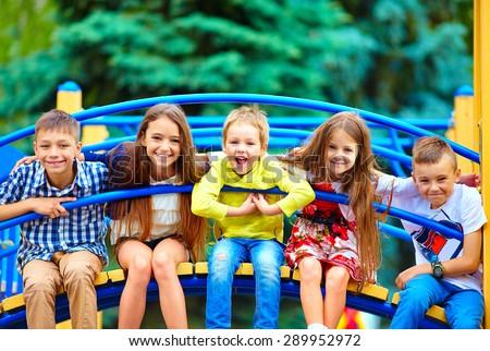group of happy kids having fun on playground