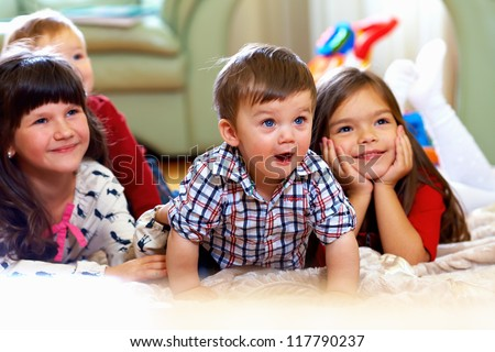 group of happy kids watching tv ...