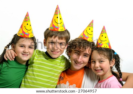 Group of happy kids with party horn