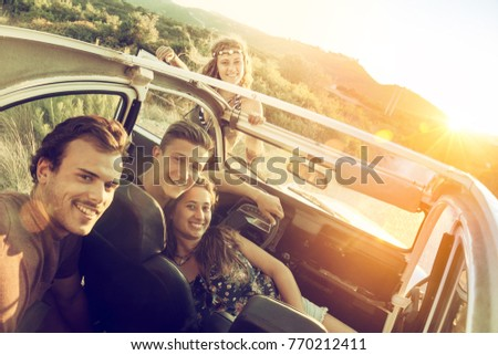 group of happy people in a car...