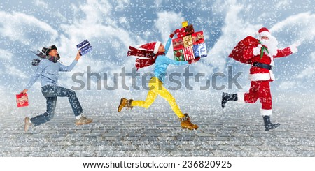Group of Happy people running with Xmas gifts. Christmas.