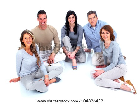 Group of happy people sitting on the floor. Isolated over white background.