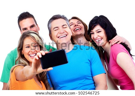 Group of happy people with a smartphone. Technology.