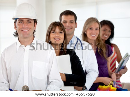 Group of happy people with different professions indoors
