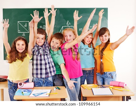Group of happy school child  in classroom.