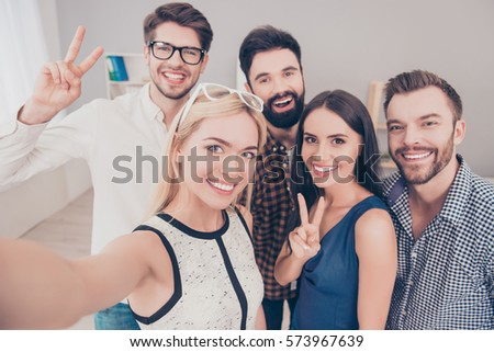 Group of happy smiling businesspeople making selfie and gesturing.
