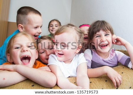 Group of happy smiling kids sitting together