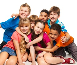 Group of happy smiling kids sitting together and playing - boys and girls black and Caucasian