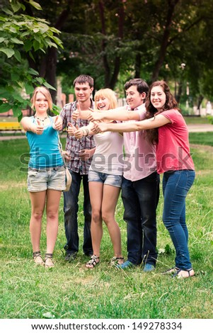 Group of happy smiling Teenage Students Outside - stock photo