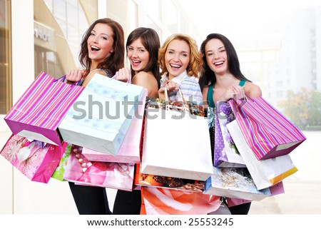 stock photo : Group of happy smiling women shopping with colored bags