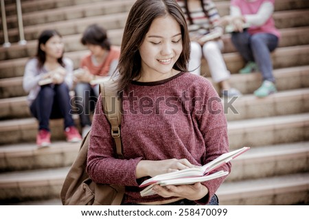 group of happy teen high school students outdoors #258470099