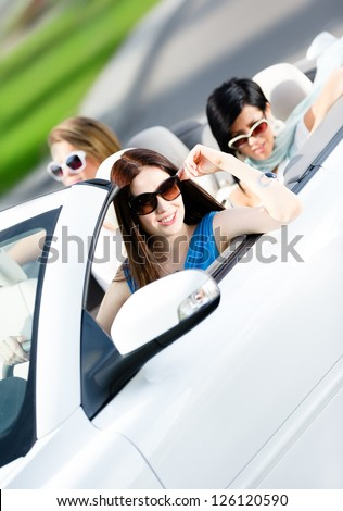 Group of happy teenagers driving the car. Adorable car trip on vacation