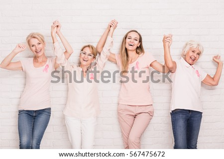 Group of happy women winning the struggle with breast cancer