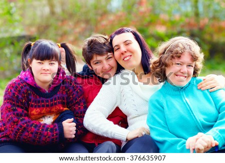 group of happy women with disability having fun in spring park #376635907