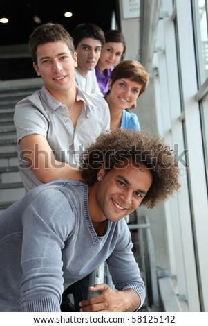 Group of happy young people at university