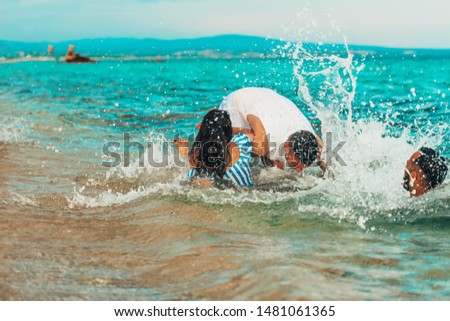 Group of happy young people enjoying summer vacation on beach