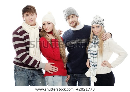 Group of happy young people in warm clothes.