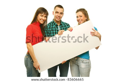 Group of happy young people standing together and holding a blank placard for your text.  Isolated on white background
