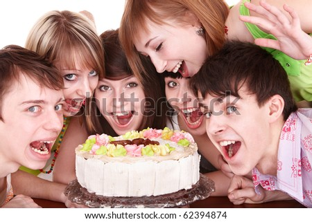 Group of happy young people with cake. Isolated.