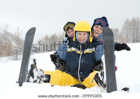 Group of happy, young skiers in the snow