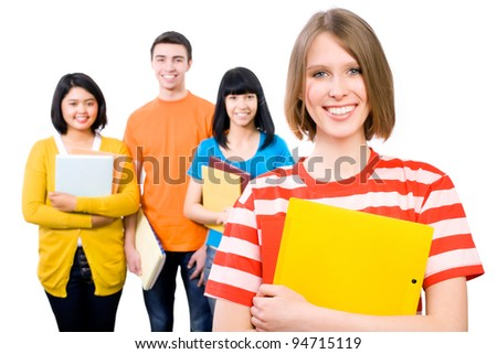 Group of happy young teenager students standing and smiling