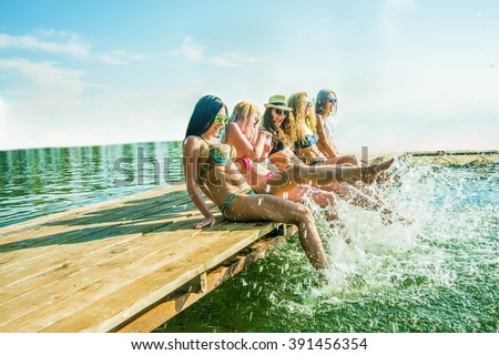 stock photo group of happy young woman feet splash water in sea and spraying at the beach on beautiful summer 391456354 - Каталог — Фотообои «Море, пляж»