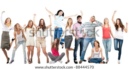 Group of happy young women and men in motion, dancing and laughing. Isolated on white background