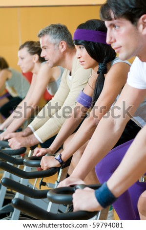 Group of healthy people doing exercise at the gym