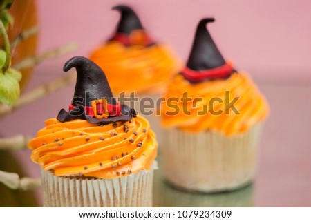 Group of helloween cupcakes on pink background. Helloween treat.