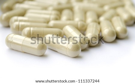 Group of herb capsules on white. RAW/Tiff present