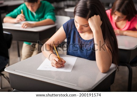 Group of high school students taking a test in a classroom