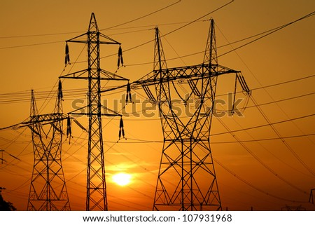 group of high voltage pole against sun