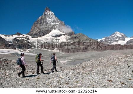 group of hikers heading towards Matterhorn