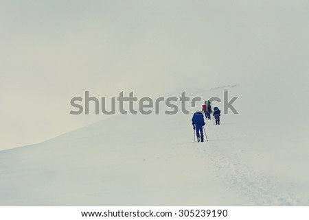 Group of hikers in the mountain. Climb to the top. mountaineering