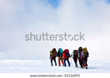 group of hikers in winter mountains #85526095