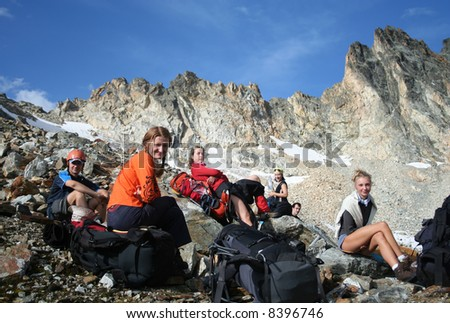 group of hikers taking a rest after descending