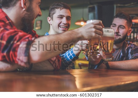 Group Of Hipster Friends Drinking Craft Beer focus on Hipster #601302317
