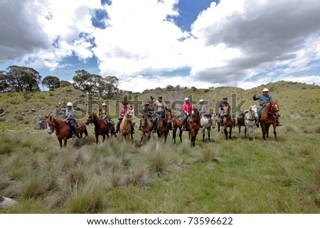 group of horse riders having fun in the mountains