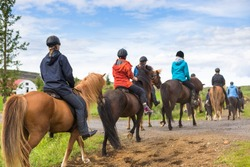 Group of horseback riders ride  in Iceland