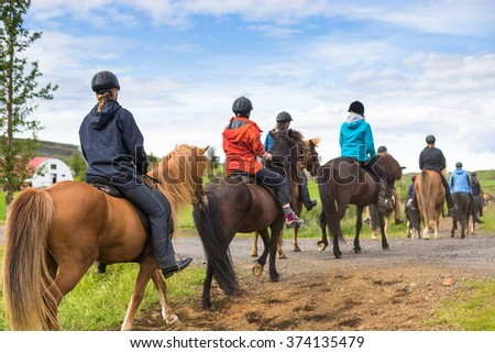 Shutterstock Group of horseback riders ride  in Iceland