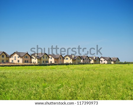 Group of houses in the countryside. Sunny summer day