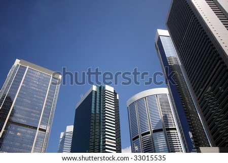 Group of huge skyscrapers against blue sky in Hong Kong, China