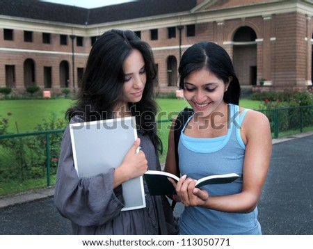 Group of Indian / Asian college students studying together at the campus.