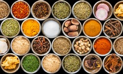 Group of indian spices and herbs difference ware on black background with top view  for design foods, vegetable, spices, herbs or other your content.