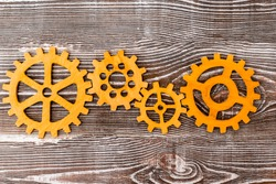 group of interconnected gears on a wooden background. concept teamwork.