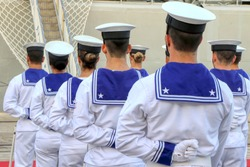 Group of Italian sailors from behind